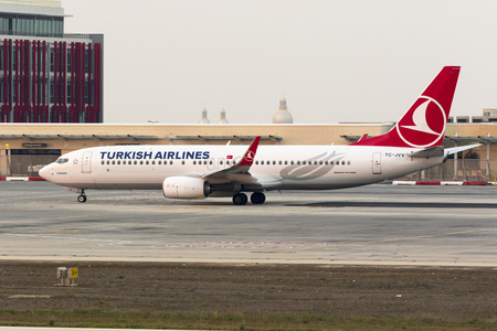 exiting: Luqa, Malta - 12 September 2016: Turkish Airlines Boeing 737-8F2 [TC-JVV] exiting apron 9 for take off from runway 13 in the late evening.
