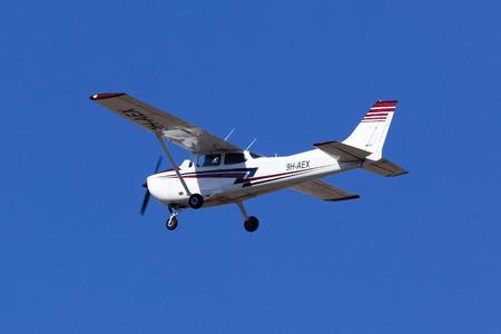 cessna: Luqa, Malta - 22 September 2016: Malta School of Flying Reims F172M Skyhawk [9H-AEX] performing a simulated engine failure landing on runway 31.