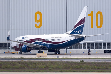 Luqa, Malta - 26 September 2016: Arik Air (of Nigeria) Boeing 737-76N [5N-MJI] being serviced at Lufthansa Technik Malta, with the no.1 engine removed.