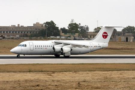 aerospace: Luqa, Malta - 12 May 2008: Orionair British Aerospace BAe-146-300 [EC-JVO] landing runway 13.