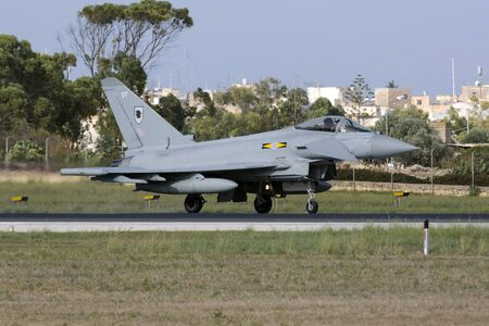 turbojet: Luqa, Malta October 20, 2015:  Royal Air Force Eurofighter EF-2000 Typhoon FGR4 taxiing on the runway after arriving with another 3 Eurofighters. Second set of 4 in 2 days.