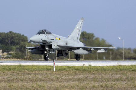 royal air force: Luqa, Malta October 20, 2015:  Royal Air Force Eurofighter EF-2000 Typhoon FGR4 taxiing on the runway after arriving with another 3 Eurofighters. Second set of 4 in 2 days.