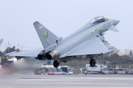 royal air force: Luqa, Malta - 20 October 2015:  Royal Air Force Eurofighter EF-2000 Typhoon FGR4 taking off runway 13 with another 3 Eurofighters. Arrived the day before for a night stop. Editorial