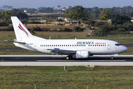 hermes: Luqa, Malta - 17 September 2015: Hermes Airlines Boeing 737-5L9 landing runway 31, operating for Air Mediterranee.
