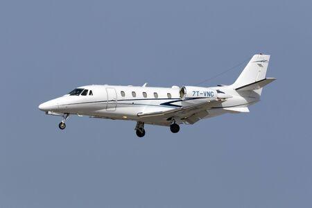 xls: Luqa, Malta July 10, 2016: Private Cessna 560XL Citation XLS Plus [7T-VNC] landing runway 31.