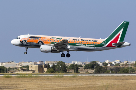 reg: Luqa, Malta - July 20, 2017: Alitalia Airbus A320-216 [REG: EI-DSW] in special color scheme promoting the Jeep Renegade on finals runway 31. Daily flight from Rome, Italy.