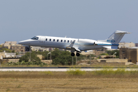 Luqa, Malta July 29, 2017: A private Learjet 45 [9H-BCP] coming in to land at midday.