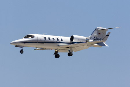 Luqa, Malta July 29, 2017: A private German registered Learjet 31A [D-CAMB] on final approach in the hot midday sun.