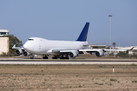 Luqa, Malta August 25, 2017: Aerotrans Cargo Boeing 747-412F [REG: ER-BBJ] exiting from taxiway Foxtrot from apron 9 for a take off from runway 13. Редакционное