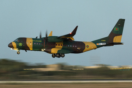 Luqa, Malta September 12, 2017: Bangladesh Army Airbus C295W [EC-006 delivery, actual S3-BRT] landing in darkness, hence shot at ISO10000 and 125s. On delivery flight arriving from Seville, Spain.