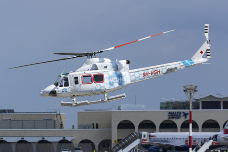 Luqa, Malta September 26, 2017: Gulf Med Aviation Services Bell 412EP [9H-VGH] taking off from runway 31. Medical helicopter operating for Vitals Global Healthcare. Editorial
