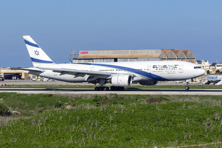 Luqa, Malta - November 13, 2018: El Al Israel Airlines Boeing 777-258ER (REG: 4X-ECB) landing runway 13, arriving for painting works at ACM Malta.