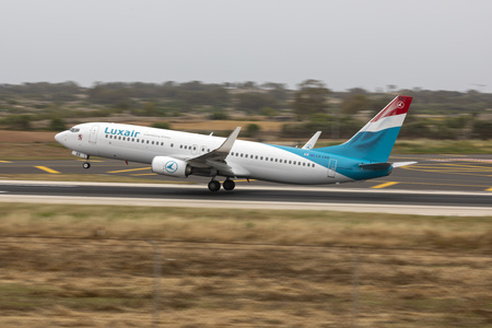 Luqa, Malta - May 18, 2019: Luxair Boeing 737-86J (REG: LX-LBB) taking off from runway 13.