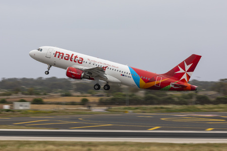 Luqa, Malta - May 18, 2019: Air Malta Airbus A320-214 (REG: 9H-AHS) taking off on a flight to Munich, Germany.