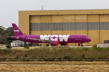 Luqa, Malta - May 18, 2019: WOW Air Airbus A321-253N (REG: TF-SKY) stored in from Medavia hangar after WOW Air ceased operations. 報道画像
