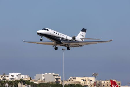 Luqa, Malta - June 19, 2019: A private Cessna 680 Citation Sovereign+ (REG: PH-MDG) taking off from runway 31.