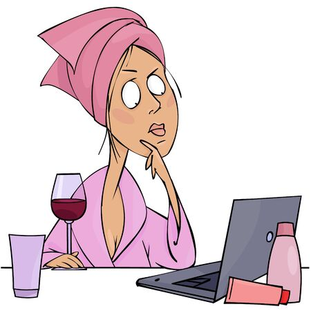 Young woman with a glass of wine and a laptop