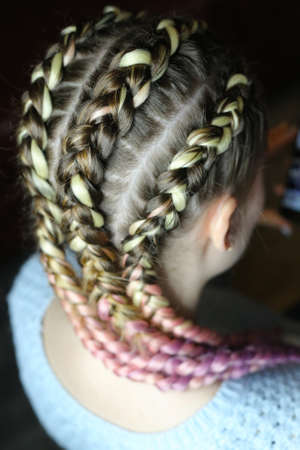 a hairstyle made of thick braid with a kanekalon for a girl, fiv