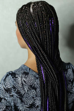 a lot of thin braids in the African style, black kanekalon, synt