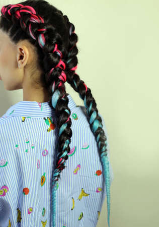 Girl with two braids blue and pink amber, fashionable youth hair Stockfoto
