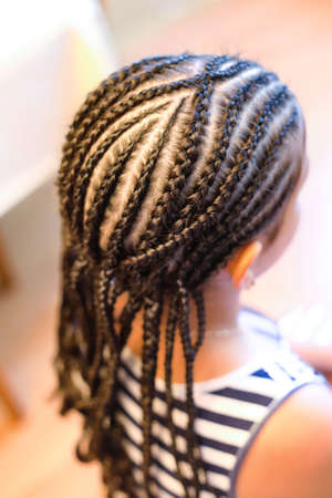the girl is braided from her own hair