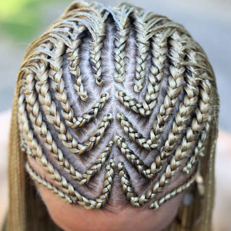 hairstyle from thin plaits close-up of head and parting, pattern