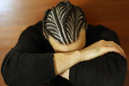 small braids on his head Man with face covered, dark hair