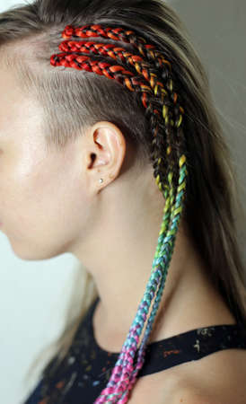 thin pigtails on the temple of a girl with a kanekalon ombre