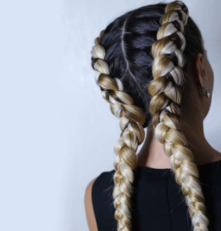two thick braids of artificial hair, hairstyle youth, colored ha Фото со стока