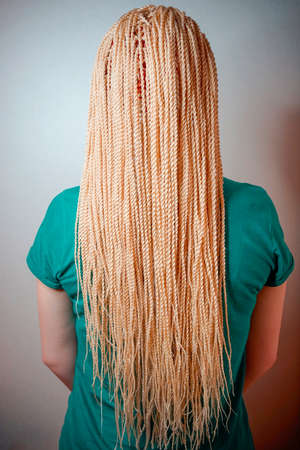 Senegalese twisted pigtails, weave through the braid, many African braids, hair is removed into the hair, the texture of the braids