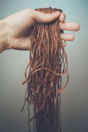 synthetic hair materials for weaving, braiding African braids zizi, Kanekalon Фото со стока