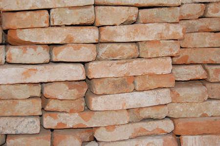 Stockpiled orange bricks photo