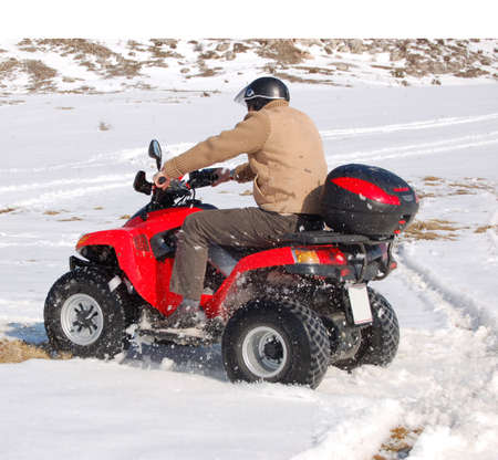 soggy: Man riding quad in mountain snow