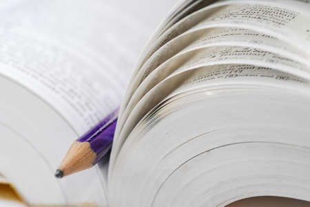 macro of book and pencil Stock Photo