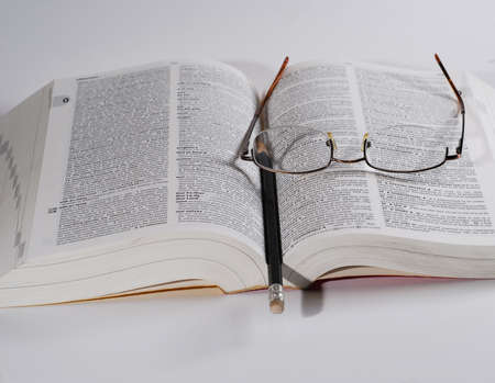 wide open book with reading glasses and pencil with eraser Stock Photo - 2021858