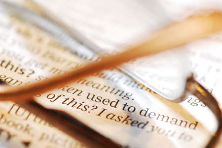 closeup photo of book and reading glasses Stock Photo