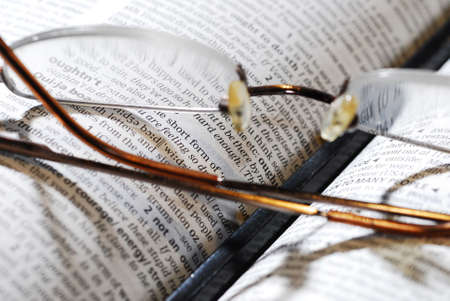 closeup photo of book and reading glasses with pencil Stock Photo - 2021857
