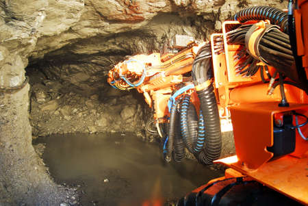 New heavy duty machine inside a mine shaft Stock Photo