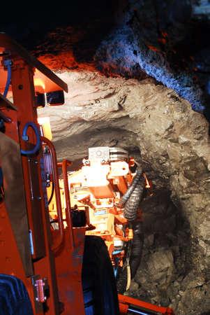heavy duty mine machine working in the shaft photo