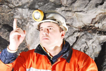 Angry chief miner in mine shaft criticizing stock photo photo