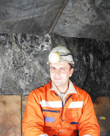 mining gold: Portrait of a happy miner in a mine shaft stock photo Stock Photo