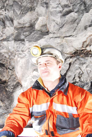 Happy miner in a mine shaft stock photo photo