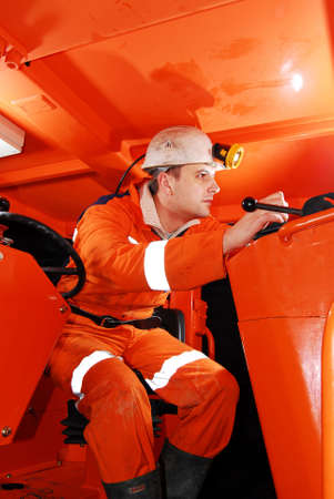 Miner in the drilling machine cockpit stock photo photo
