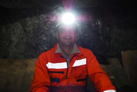 Portrait of a miner in a mine shaft stock photo
