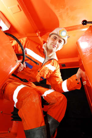 Miner working in a mine shaft stock photo Imagens
