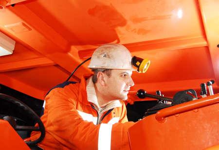 Modern miner working in a mine shaft stock photo Standard-Bild
