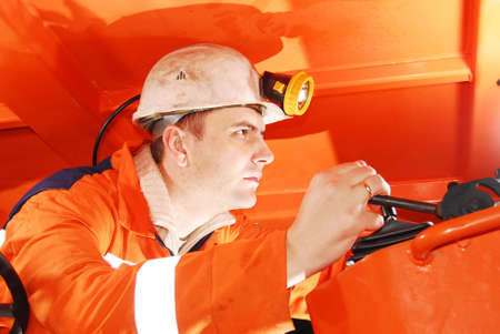 Serious miner working in a mine shaft stock photo photo
