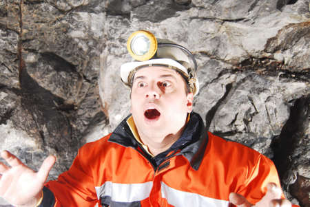 prospector: Surprised miner in a mine shaft stock photo Stock Photo