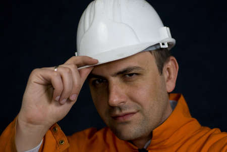Miner saluting with his hardhat stock photo