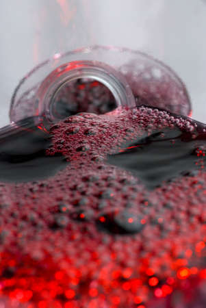 Wine pouring in a glass captured from unusual POV inside the bottle stock photo Stock Photo
